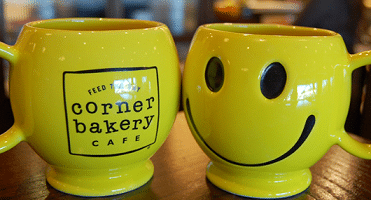 Free Smiley Mug at Corner Bakery Cafe on 10/2